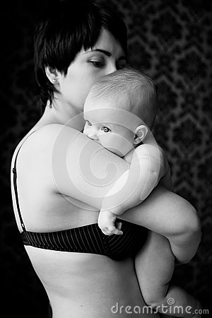 Mother holding a chubby baby