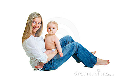Mother holding cute infant girl