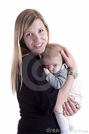 Mother holding her baby with tenderness