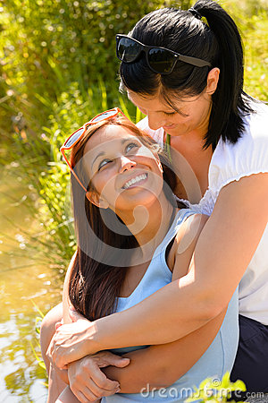 Mother holding her teen daughter in arms