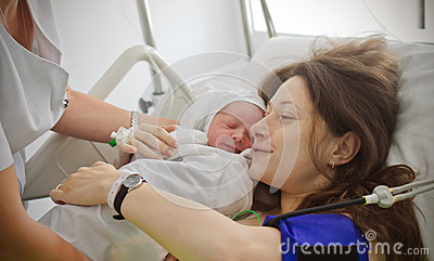 Mother holding newborn baby