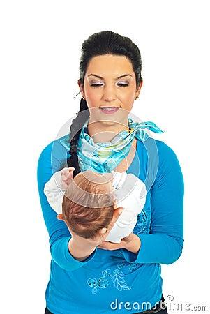 Mother holding newborn baby in her hands