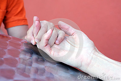 Mother holding Sons Hand Close Up