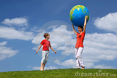 Mother holds hands ball, boy comes running to it