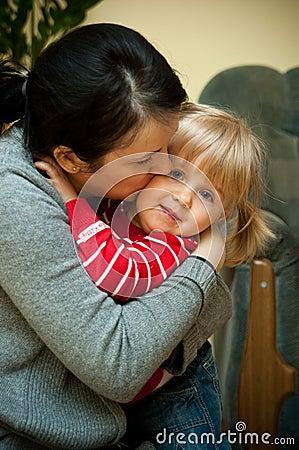 Free Mother Hugging Daughter Stock Image - 22992551