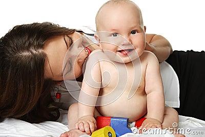Mother hugging little baby boy.