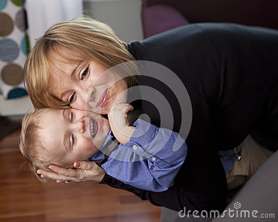 Mother hugs son