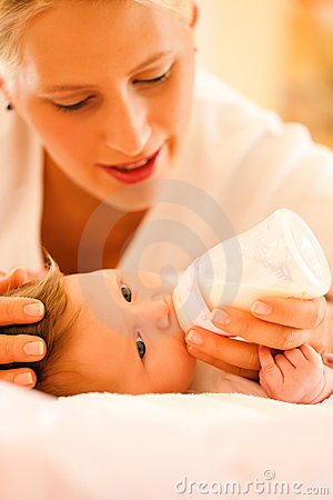 Free Mother Is Feeding The Baby Royalty Free Stock Image - 18235556