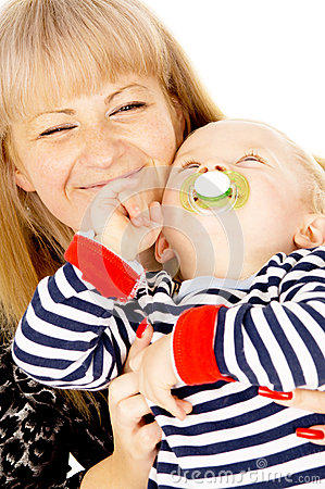 Mother keep nice little baby in her arms, sucking a pacifier