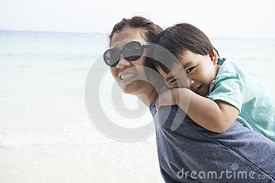 Mother and kid relaxing emotion on sand beach