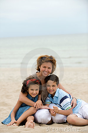 Mother and kids on the beach