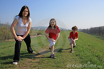 Mother with kids exercising