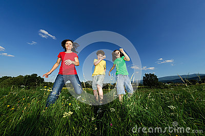Mother with kids jumping