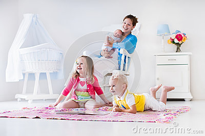 mother and kids playing in bedroom stock photo image