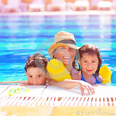 Mother with kids in poolside