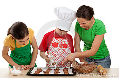 Mother with  kids preparing cakes