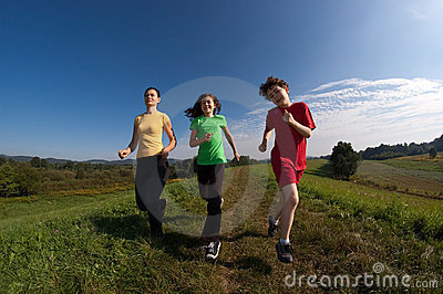 Mother With Kids Running Royalty Free Stock Photo - Image: 10781055