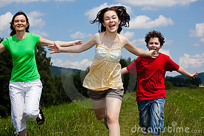 Mother with kids running outdoor