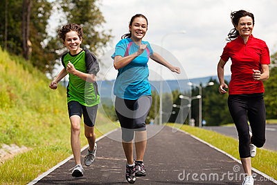 Mother with kids running in park