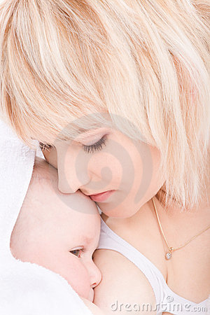 Mother kiss and breast feeding her baby