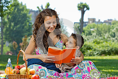 Mother and little boy reading