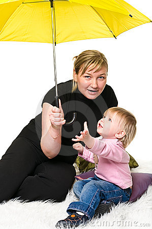 Mother and little child under umbrella