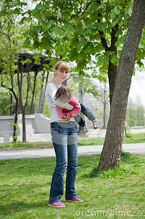 Mother and little daughter on nature