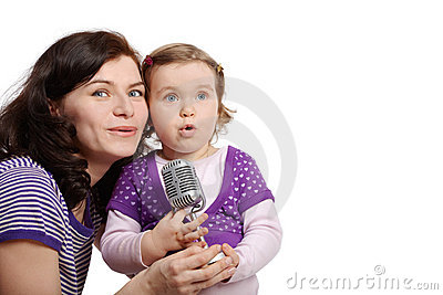 Mother with little daughter sing into microphone Stock Photo