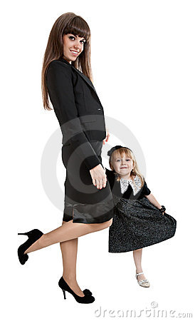 Mother with little girl standing on one leg