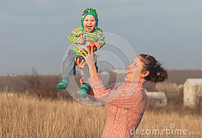 Mother with little laugh son