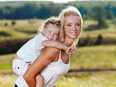Mother and little pretty girl outdoors