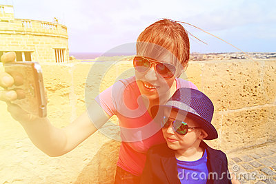 Mother and little son making selfie while travel Stock Photo
