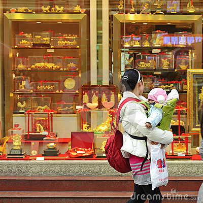 A mother looking in the window of a gold shop Editorial Photo