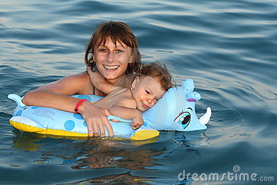 Mother mom with baby swimming