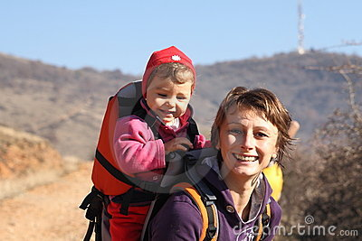 Mother mom with baby trekking