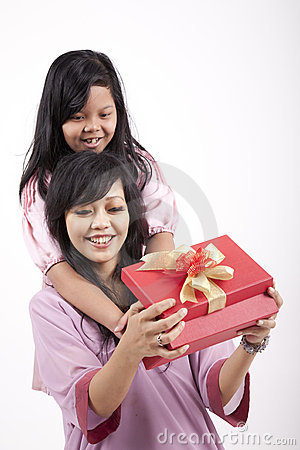 Mother opening a gift from her daughter