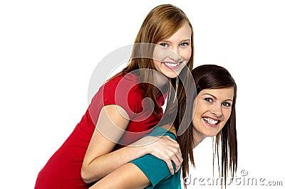 Mother piggybacks her teenage girl