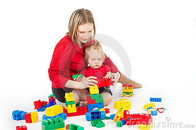 Mother playing with child over white