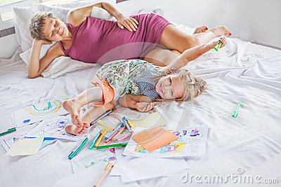 Mother playing and drawing with her baby daughter Stock Photo