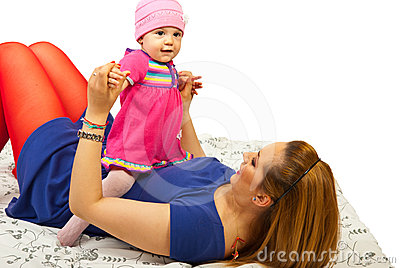 Mother playing with her baby girl