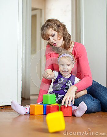 Mother Plays With Baby  In Home Royalty Free Stock Images - Image: 26506289