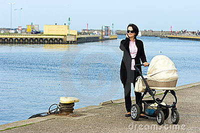 Mother with pram by sea