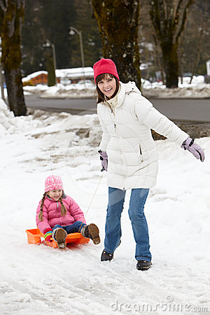 Mother Pulling Daughter On Sledge