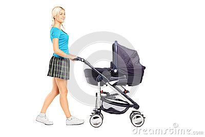 Mother pushing a baby stroller