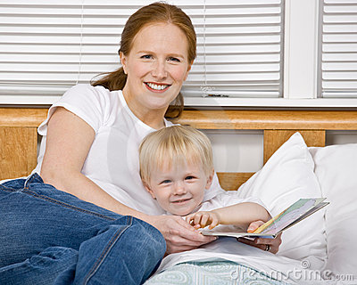 Mother reading son a bedtime story in bed