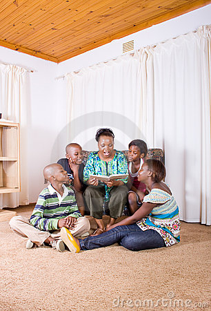 Mother reading story to children