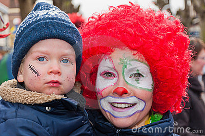 Mother with red wig and child with a blue cap. Editorial Stock Photo