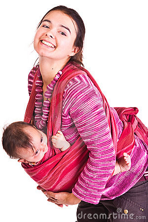 Mother rocks baby to sleep in sling