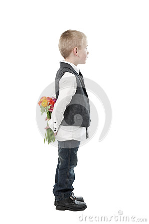 Mother s day, little boy hiding flowers behind his back.