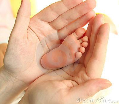 Mother s hands and baby s foot